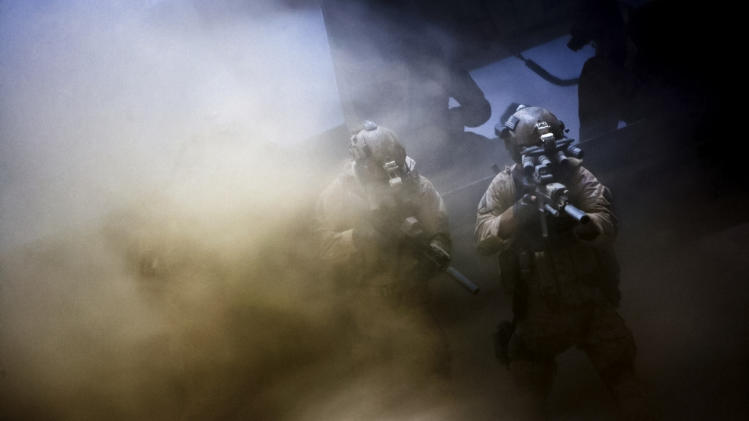 "This undated publicity film image provided by Columbia Pictures Industries, Inc. shows Navy SEALs fighting through a dust storm to undertake the greatest manhunt in history in Columbia Pictures' gripping new thriller directed by Kathryn Bigelow, ""Zero Dark Thirty."" The National Board of Review has named ""Zero Dark Thirty""  the 2012 Best Film of the Year.  (AP Photo/Columbia Pictures)"