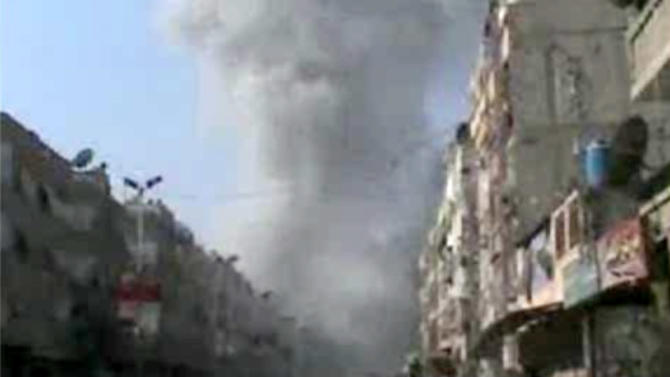 In this image taken from video obtained from Bambuser, which has been authenticated based on its contents and other AP reporting, smoke rises from buildings after an airstrike hit Douma City, Syria on Thursday, Jan. 3, 2013. Airstrikes continued across Syria on Thursday as Syrian President Bashar Assad's military stepped up its assault on areas that surround the nation's capital. (AP Photo/Bambuser via AP video)