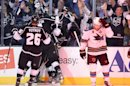 Members of the Los Angeles Kings celebrate center Trevor Lewis&#039;s game winning goal as San Jose Sharks center Joe Pavelski skates off during the third period in Game 2 of their second-round NHL hockey Stanley Cup playoff series, Thursday, May 16, 2013, in Los Angeles. (AP Photo/Mark J. Terrill)