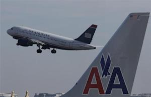 File photo of U.S. Airways jet departing Washington's Reagan National Airport next to American Airlines jets outside Washington