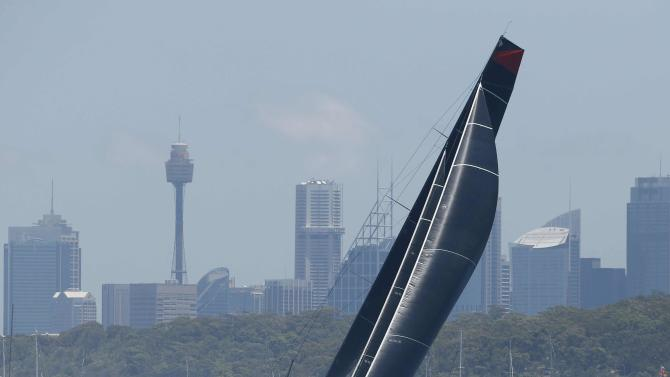 Comanche races out of Sydney Harbour at the start of the Sydney to Hobart Yacht Race