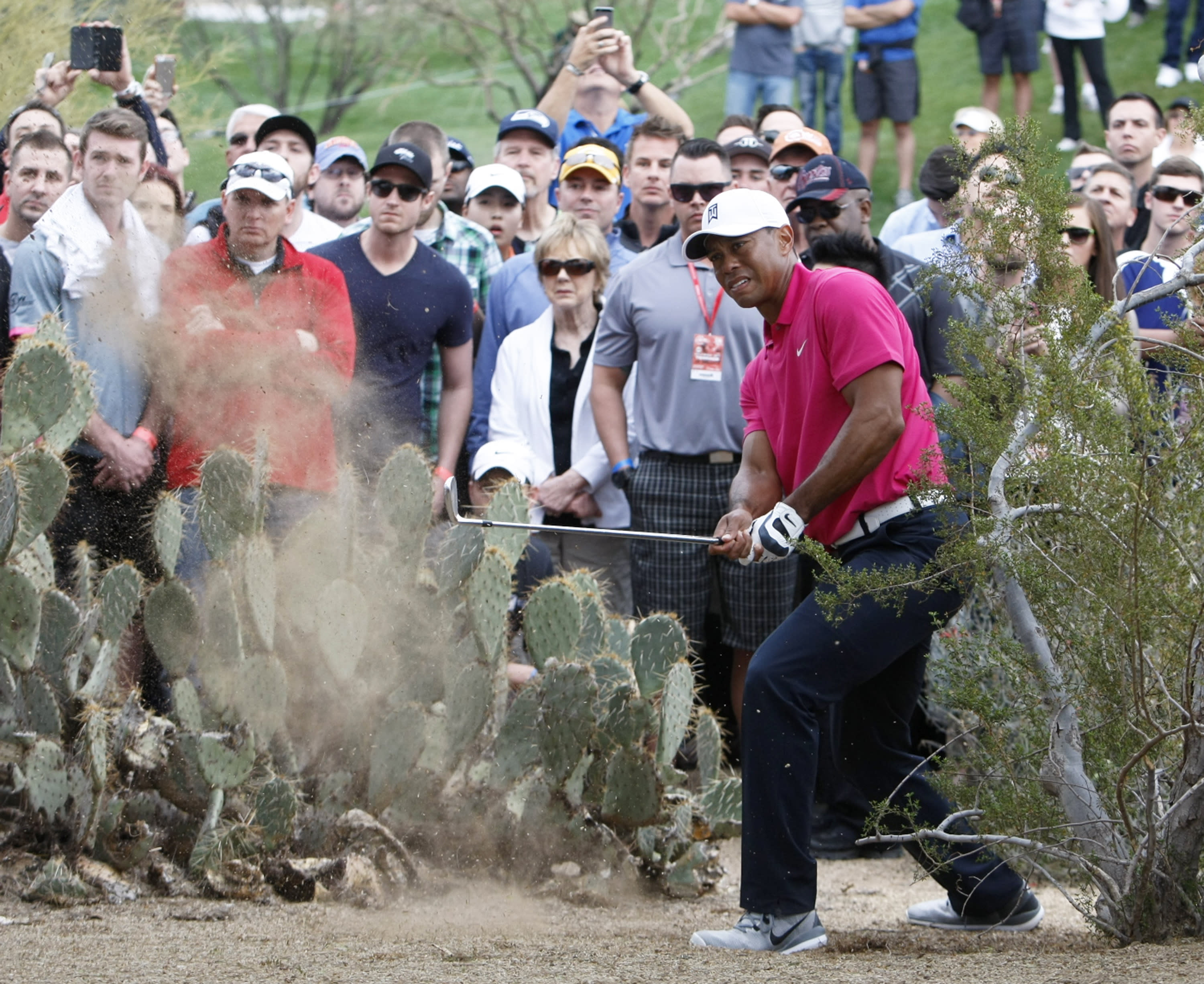 Woods stumbles with chipping in return to golf