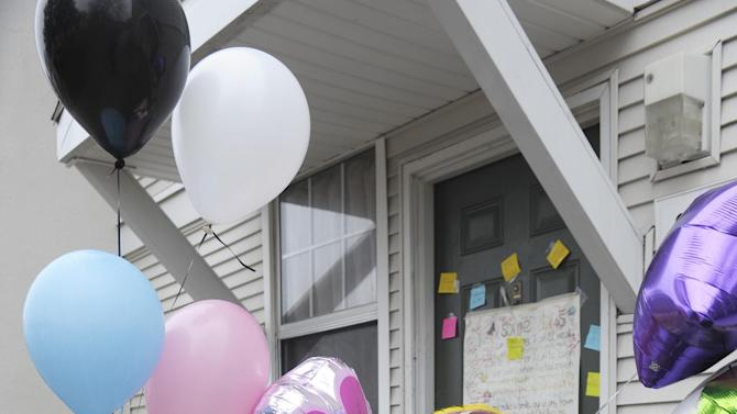 Notes are left on the door at a town home in Detroit, Wednesday, March 25, 2015, where two bodies were found. A Detroit mother was arrested Tuesday after the frozen bodies of a boy and girl were found in a deep freezer in the family's home, police said. Court officers found the children's bodies while carrying out an eviction order at the 3-bedroom home in the apartment complex. (AP Photo/Detroit News, Clarence Tabb Jr.)  DETROIT FREE PRESS OUT; HUFFINGTON POST OUT; MANDATORY CREDIT