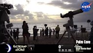 Observers set up their gear in anticipation of a total solar eclipse over Australia on Nov. 13, 2012.