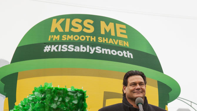 """IMAGE DISTRIBUTED FOR GILLETTE -Football Hall of Fame star Dan """"Danimal"""" Hampton declares """"Kiss Me, I'm Smooth Shaven!"""" on board the Gillette float during the St. Patrick's Day Parade in Chicago, on Saturday, March 16, 2013. (Photo by Barry Brecheisen/Invision for Gillette/AP Images)"""