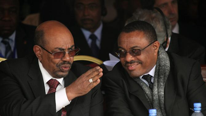 """Ethiopian prime minister Hailemariam Dessalegni and Sudan's President Omar al-Bashir chat during the the first year anniversary ceremonyof the death of long-time ruler Meles Zenawi in Addis Ababa, Ethiopia, Tuesday Aug. 20, 2013. The ceremony attended by regional leaders including presidents of Somalia and Sudan, Meles was praised as """"Africa's voice."""" His successor Prime Minister Prime Minister Hailemariam Desalegn praised Meles as a """"champion of the poor."""" (AP Photo/Elias Asmare)"""