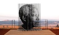 South Africa unveiled its latest monument to Nelson Mandela, a new statue along a rural highway marking the spot where he was arrested 50 years ago for his struggle against apartheid