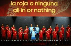 Spain's national soccer team players wearing the new Spanish kit for the upcoming 2014 World Cup stand on the stage during a presentation ceremony in Madrid