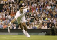 Novak Djokovic of Serbia returns a shot against Ryan Harrison of the United States during a second round men's singles match at the All England Lawn Tennis Championships at Wimbledon, England, Wednesday, June 27, 2012. (AP Photo/Kirsty Wigglesworth)