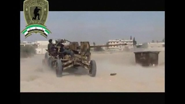 Fighting rages in strategic Syrian town