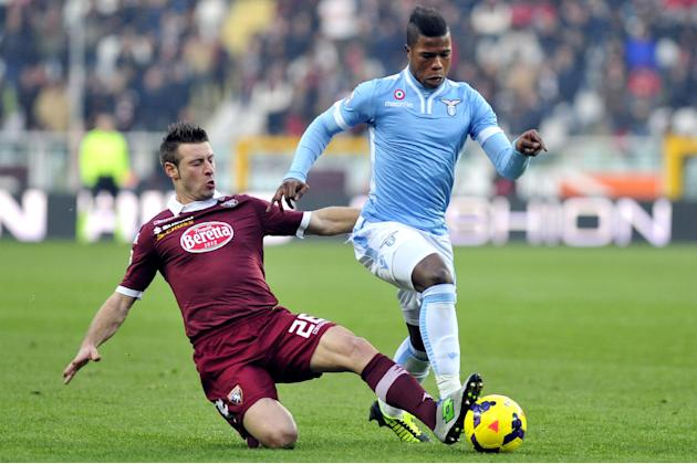 Lazio forward Balde Diao Keita of Spain is challenged by Torino defender Giovanni Pasquale during a Serie A soccer match between Torino and  Lazio at the Olympic stadium, in Turin, Italy, Sunday, Dec.