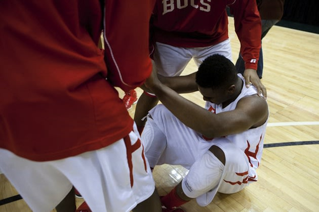 Flint Beecher star Monte Morris sits on the court after winning a state title with the flu — MLive.com/The Flint Journal