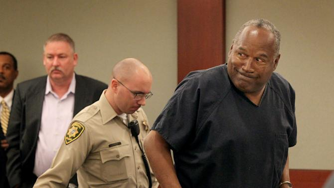O.J. Simpson gets up after the first day at his  evidentiary hearing for Simpson in Clark County District Court on Monday, May 13, 2013 in Las Vegas. Simpson, who is currently serving a nine-to-33-year sentence in state prison as a result of his October 2008 conviction for armed robbery and kidnapping charges, is using a writ of habeas corpus, to seek a new trial, claiming he had such bad representation that his conviction should be reversed. (AP Photo/Las Vegas Review-Journal, Jeff Scheid, Pool)
