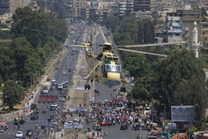 An Egyptian military helicopter flies over Egyptians…