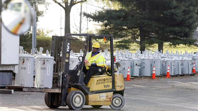 FILE - In this Thursday, Nov. 1, 2012 file photograph, after Superstorm Sandy, PSE&G employee Percy Thompson III unloads new electrical transformers in a staging area at the Quaker Bridge Mall in Lawrence Township, N.J. New Jersey's largest utility company is proposing to spend $3.9 billion to protect its electric and gas system against future storms like Sandy. PSE&G says it wants to strengthen distribution lines, protect utility stations from storm surges and make the electrical grid easier to repair. (AP Photo/Mel Evans, File)