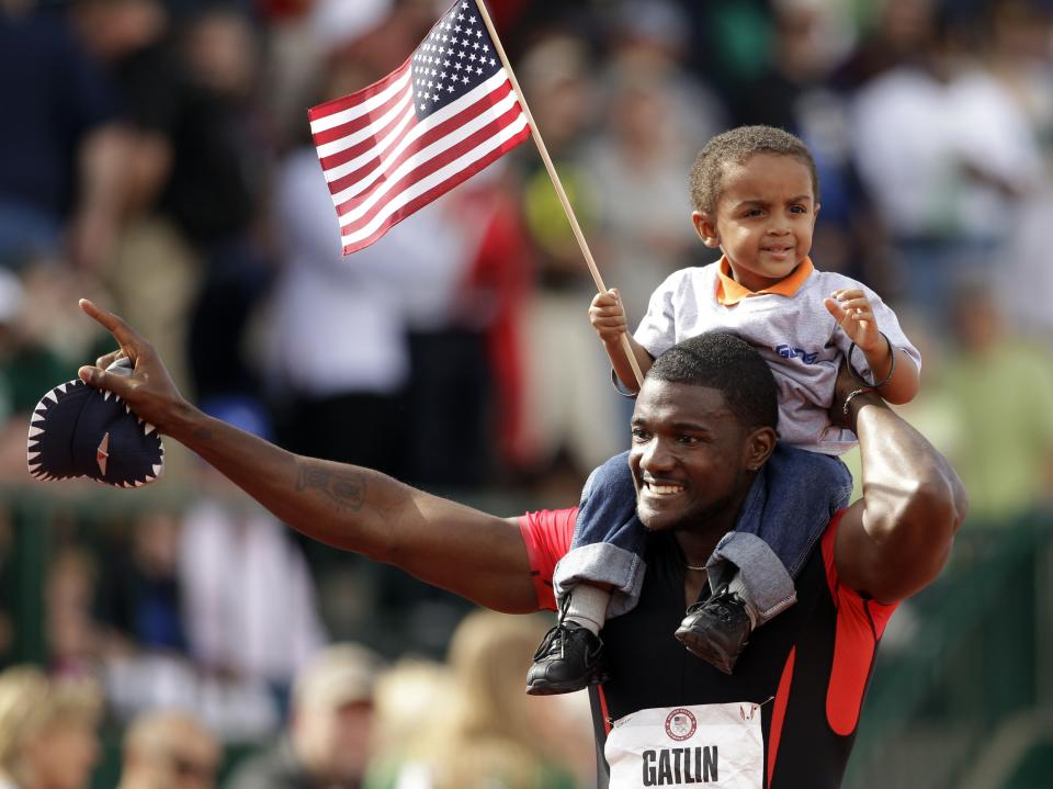 Justin Gatlin celebrates with his son Jace after winning the men's 100m finals at the U.S. Olympic Track and Field Trials Sunday, June 24, 2012, in Eugene, Ore.(AP Photo/Marcio Jose Sanchez)
