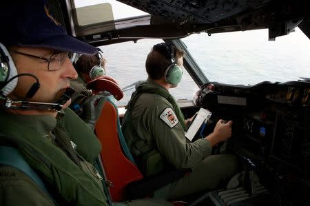 File photo of co-pilot and crewmen aboard an aircraft while on search for the missing Malaysian Airlines Flight MH370 over the southern Indian Ocean