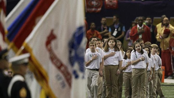 Students from Sandy Hook Elementary School stand at attention as Alicia Keys performs the national anthem before the NFL Super Bowl XLVII football game between the San Francisco 49ers and the Baltimore Ravens, Sunday, Feb. 3, 2013, in New Orleans. (AP Photo/Elise Amendola)