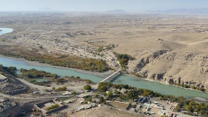 This Thursday, Nov. 15, 2012 aerial photo shows the Helmand River in Helmand province, south of Kabul, Afghanistan. In the approaching twilight of its war in Afghanistan, the U.S. is forging ahead with a giant infrastructure project long criticized as too costly in both blood and money. (AP Photo/Heidi Vogt)