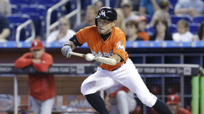 Miami Marlins' Ichiro Suzuki, of Japan, attempts a bunt during the first inning of a baseball game against the Philadelphia Phillies, Sunday, May 3, 2015, in Miami. (AP Photo/Wilfredo Lee)