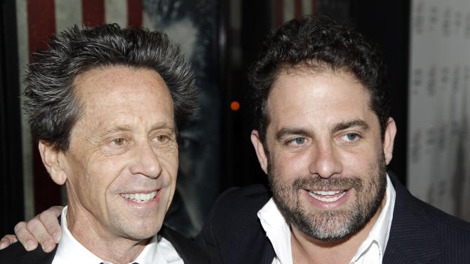 "FILE - In this Nov. 3, 2011 file photo, ""Tower Heist"" producer Brian Grazer, left, and director Brett Ratner pose together at the premiere of ""J. Edgar"" during the Opening Night Gala of AFI FEST 2011 in Los Angeles. The Academy of Motion Picture Arts and Sciences announced Wednesday, Nov. 9, 2011, that Grazer will produce the 84th Academy Awards. On Wednesday, Brett Ratner stepped down as producer of the show on Tuesday. (AP Photo/Matt Sayles, file)"