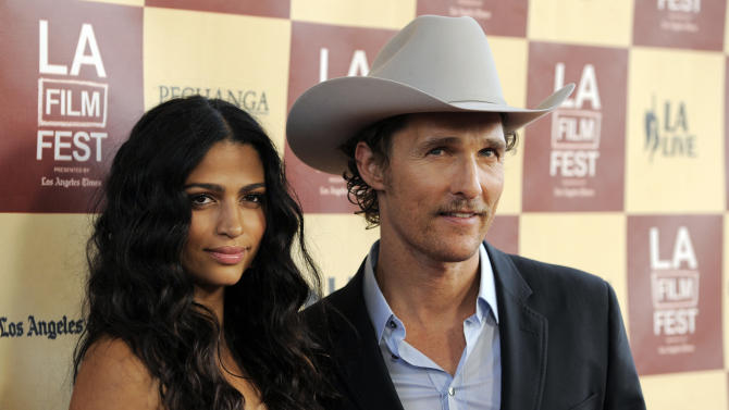 """Matthew McConaughey, a cast member in """"Bernie,"""" poses with his wife Camila Alves at the premiere of the film on the opening night of the 2011 Los Angeles Film Festival, Thursday, June 16, 2011, in Los Angeles. (AP Photo/Chris Pizzello)"""