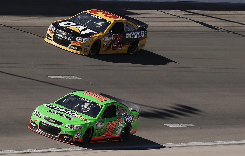 Danica Patrick (10) and Aric Almirola make their way into turn two during the NASCAR Sprint Cup Series auto race, Sunday, March 10, 2013 in Las Vegas. (AP Photo/Julie Jacobson)