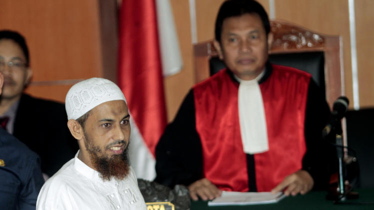 Umar Patek, an Indonesian militant charged in the 2002 Bali terrorist attacks, arrives to his trial in Jakarta, Indonesia, Monday, Feb. 13, 2012. (AP Photo/Tatan Syuflana)