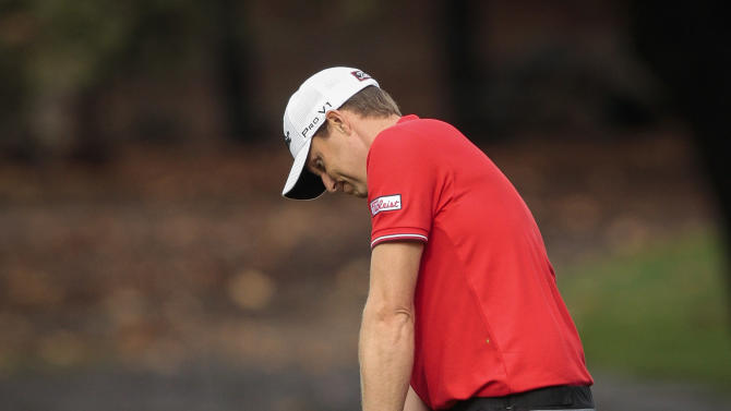Nick Watney makes a chip on the fifth hole during the second round of the World Challenge golf tournament at Sherwood Country Club in Thousand Oaks, Calif., Friday, Nov. 30, 2012. (AP Photo/Bret Hartman)