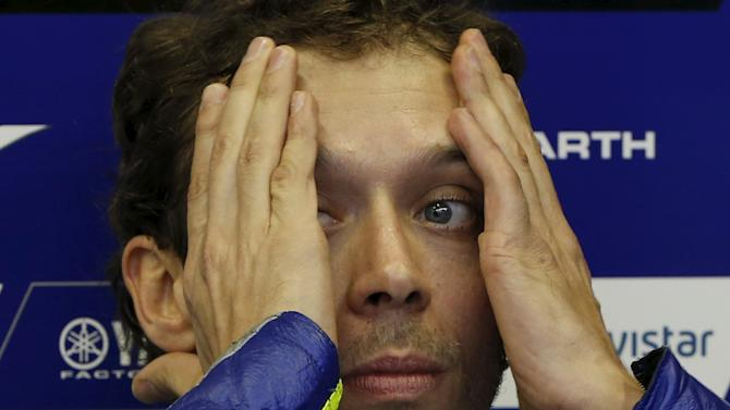 Yamaha MotoGP rider Valentino Rossi of Italy wipes his face in his garage during qualifying session for Sunday's Japanese Grand Prix at the Twin Ring Motegi circuit in Japan