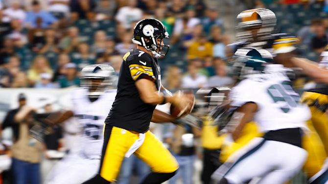 In this image made with a slow shutter speed, Pittsburgh Steelers' Ben Roethlisberger rushes during the second half of an NFL preseason football game against the Philadelphia Eagles, Thursday, Aug. 21, 2014, in Philadelphia. (AP Photo/Matt Rourke)