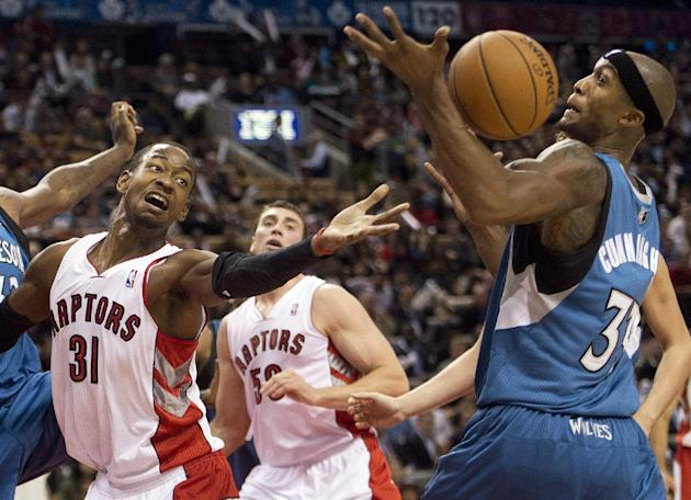 Toronto Raptors forward Terrence Ross (31) battles for the loose ball against Minnesota Timberwolves forward Dante Cunningham, right, during the first half of an NBA preseason basketball game in Toron