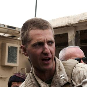 Discharged Marine considered using classified documents in book