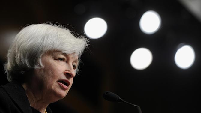 FILE - In this July 2, 2014, file photo, Federal Reserve Chair Janet Yellen speaks at the International Monetary Fund in Washington. Yellen testifies to a Senate committee to deliver the Fed's twice-a-year report to Congress on interest-rate policy and the economy on Tuesday, July 15, 2014. (AP Photo/Susan Walsh, File)