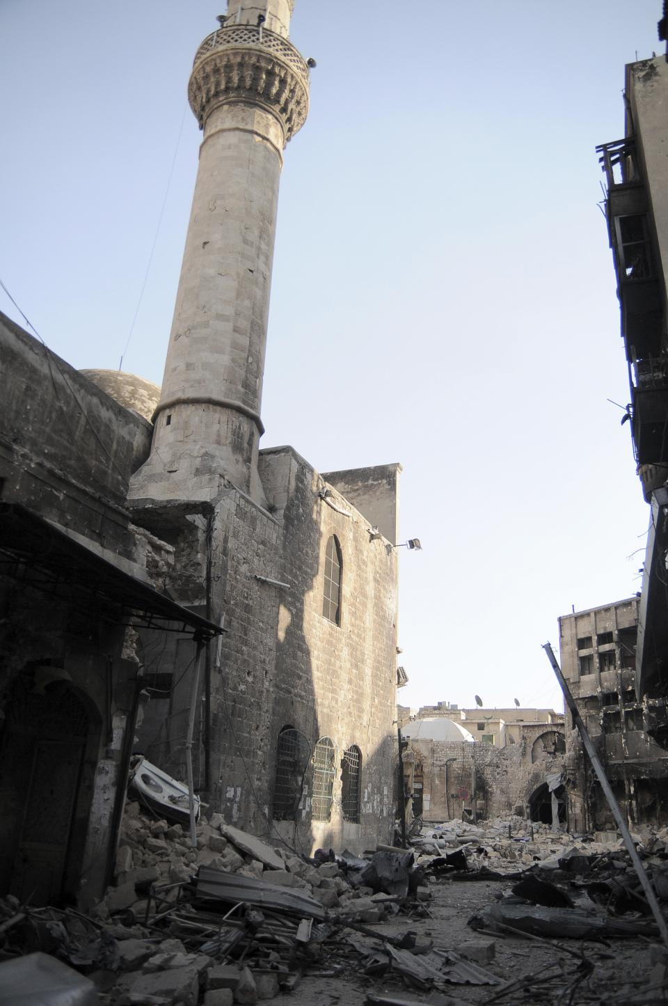 In this Tuesday, Nov. 6, 2012 photo, a mosque on Bab al-Nasser street, seriously damage by the shelling and fighting, is seen in the Old City of Aleppo, Syria, now controlled by the Free Syrian Army.(AP Photo/Monica Prieto)