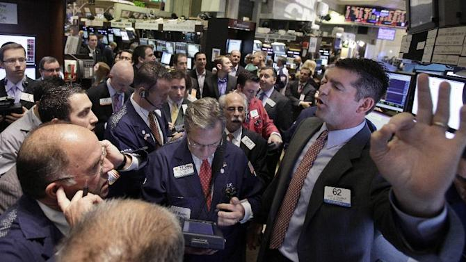 In this Nov. 9, 2011 photo, traders gather at the post of specialist David Haubner, right, on the floor of the New York Stock Exchange. European markets recovered some lost ground Thursday, Nov. 10, 2011, as Italy's borrowing rates eased somewhat on speculation that a technocratic government led by economist Mario Monti will replace Premier Silvio Berlusconi. (AP Photo/Richard Drew)
