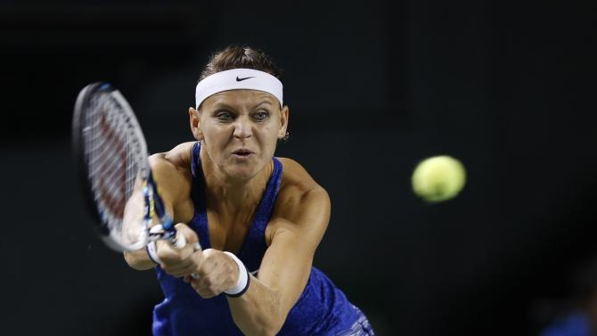 Safarova returns a shot to Ivanovic during their Pan Pacific Open women's singles quarterfinal tennis match in Tokyo