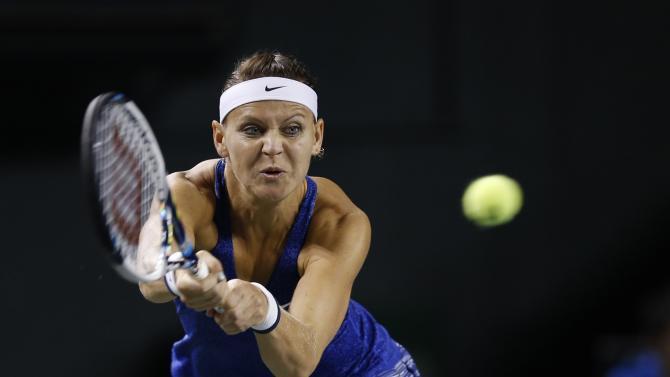 Safarova returns a shot to Ivanovic during their Pan Pacific Open women's singles quarterfinal tennis match in Tokyo