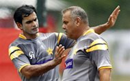 Pakistan's captain Mohammad Hafeez (L) discusses with team coach Dav Whatmore during a practice session ahead of their Twenty20 World Cup match against Bangladesh in Pallekele September 24, 2012. REUTERS/Dinuka Liyanawatte