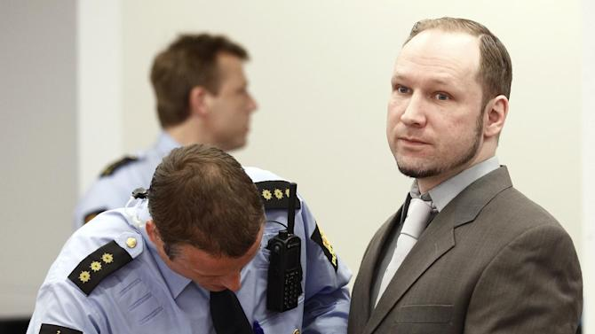 """Terror- and murder charged Anders Behring Breivik has his handcuffs released as he arrives in the courtroom in Oslo Tuesday April 24, 2012. Confessed mass killer Anders Behring Breivik vehemently defended his sanity after a forensic panel found flaws in a psychiatric report that declared him sane in the eyes of the law. As the trial for Breivik's bomb-and-shooting rampage that killed 77 people entered its second week, Monday, the far-right fanatic told a court that he was the victim of a """"racist"""" plot to discredit his ideology. He said no one would have questioned his sanity if he were a """"bearded jihadist."""" (AP Photo/Fredrik Varfjell, Pool)"""