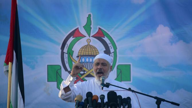 Gaza's Palestinian Prime Minister Ismail Haniyeh speaks during the Eid al-Fitr prayers in Yarmouk Stadium in Hamas- ruled Gaza City, Thursday, Aug. 8, 2013. Muslims are celebrating the Eid al-Fitr feast which marks the end of the holy fasting month of Ramadan. (AP Photo/Hatem Moussa)
