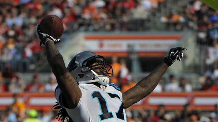 Carolina Panthers wide receiver Legedu Naanee (17) celebrates after scoring on a 19-yard touchdown pass against the Tampa Bay Buccaneers during the second quarter of an NFL football game on Sunday, Dec. 4, 2011, in Tampa, Fla. (AP Photo/Brian Blanco)