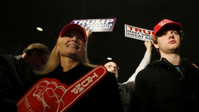 Supporters wait for Republican U.S. presidential candidate Donald Trump at his 2016 New Hampshire presidential primary night rally in Manchester