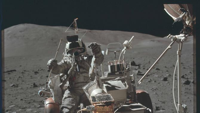 Scientist-astronaut Harrison H. Schmitt is photographed seated in the Lunar Roving Vehicle (LRV) during the third Apollo 17 extravehicular activity during the Apollo 17 mission in this NASA handout photo