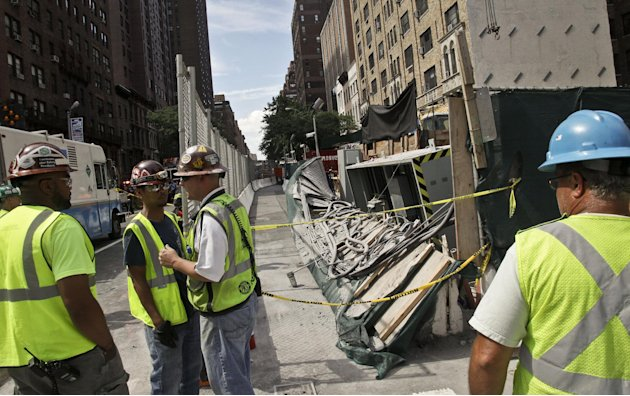 Workers examine damage following an intentional underground explosion on the Second Avenue subway project on East 72nd on Tuesday, Aug. 21, 2012. Blasting at the construction site for a New York City