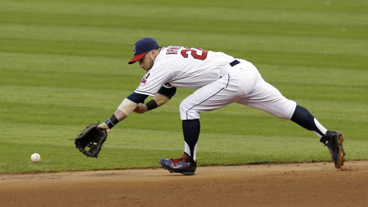 Cleveland Indians' Jason Kipnis reaches for a single hit by Seattle Mariners' Logan Morrison in the fifth inning of a baseball game Wednesday, July 30, 2014, in Cleveland. (AP Photo/Tony Dejak)