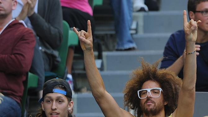 American rapper Redfoo, right, watches the women's final between Victoria Azarenka of Belarus and China's Li Na at the Australian Open tennis championship in Melbourne, Australia, Saturday, Jan. 26, 2013. (AP Photo/Andrew Brownbill)