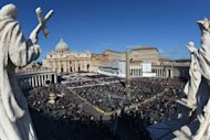 Faithful stand on St Peter's Square prior to Pope Francis's inauguration mass on March 19, 2013 at the Vatican