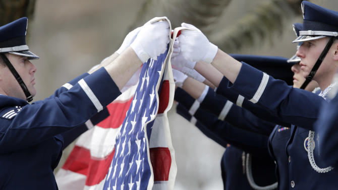 Joint Base McGuire-Dix-Lakehurst Base Honor Guard members fold a flag during a burial service at the West Point Cemetery on Friday, March 22, 2013, in West Point, N.Y. The service was for Maj. Gen. Robert Strong and wife Virginia Strong. Graves of soldiers from every U.S. war make this small plot of the land the most hallowed ground on the nation's the most venerable military academy. And after 196 years and more than 8,000 souls, it's close to full. (AP Photo/Mike Groll)