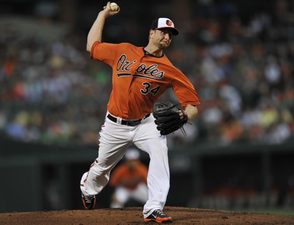 Baltimore Orioles pitcher Scott Feldman throws against the Boston Red Sox in the first inning of a baseball game on Saturday, July 27, 2013, in Baltimore. (AP Photo/Gail Burton)